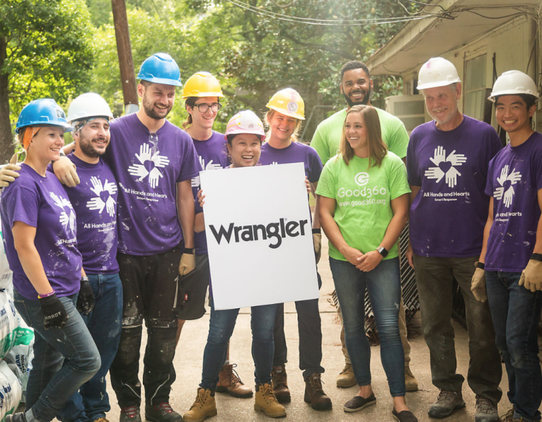 Volunteers holding a Wrangler sign